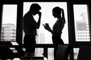 woman talking to her stressed boss
