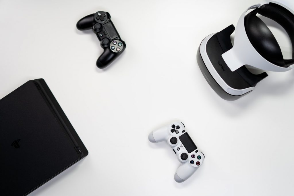 video game console, 2 controllers and a vr headset