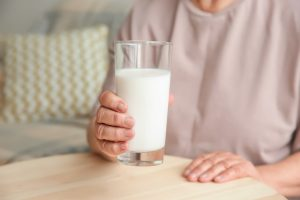 holding a glass of milk
